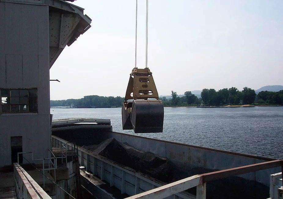 Clamshell Digging Barge on Mississippi