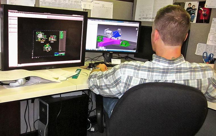 Office Engineer Designing Positioner Arm
